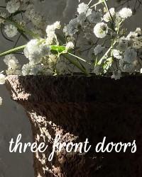THREE FRONT DOORS